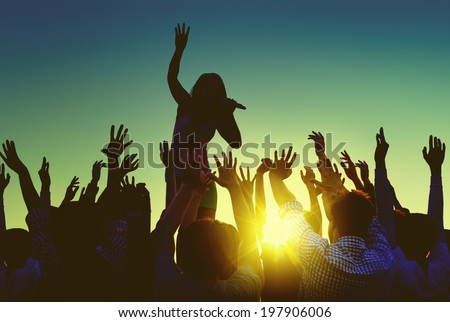 Silhouettes of People at Outdoors Music Festival Royalty-Free Stock Photo #197906006