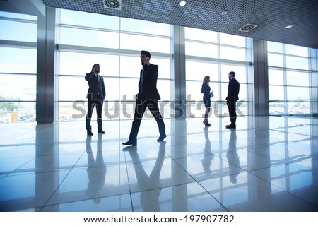 Several office workers on background of window #197907782
