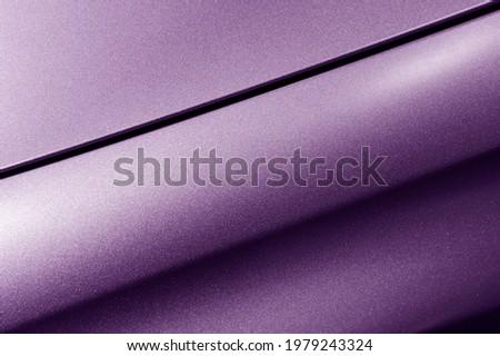 Surface of violet sport sedan car metal hood, part of vehicle bodywork, steel gradient line pattern, automobile industry, selective focus Royalty-Free Stock Photo #1979243324