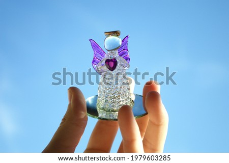Funny figurine in the form of an angel with a heart
