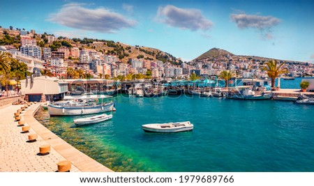 Perfect spring cityscape of Saranda port. Picturesque Ioninian seascape. Bright morning scene of Albania, Europe. Traveling concept background. Royalty-Free Stock Photo #1979689766