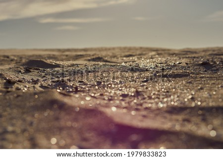 yellow sand shining in the sun, grey sky, landscape. High quality photo Royalty-Free Stock Photo #1979833823
