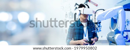Male Engineers Maintenance Robot Arm at Lab. he are in a High Tech Research Laboratory with Modern Equipment. Professional Japanese Development Engineer is Testing an Artificial Intelligence.start up Royalty-Free Stock Photo #1979950802