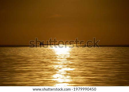 sunset at sea. variety of colors and hues of the rising sun. Sea landscape. Royalty-Free Stock Photo #1979990450