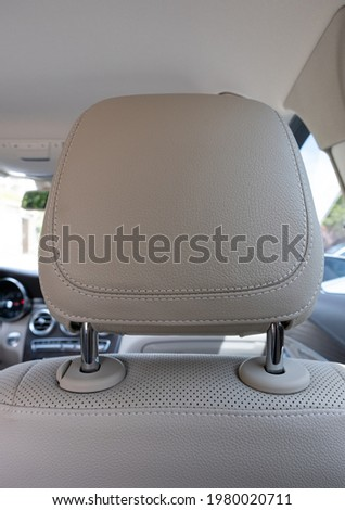 headrest in modern luxury comfortable car with the beige perforated leather Royalty-Free Stock Photo #1980020711