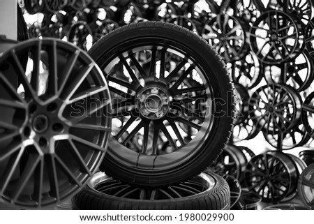 Black alloy wheels and wheels for cars. Purchase and replacement of tires and car disks. Royalty-Free Stock Photo #1980029900