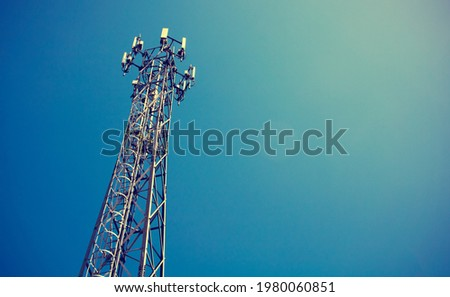 Telecom mast or Telecommunication mast TV antennas wireless technology with blue sky background, Show telecom tower infrastructure. Vintage concept Royalty-Free Stock Photo #1980060851