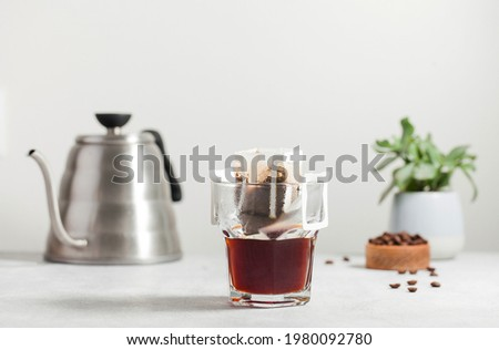 Drip coffee bag in a mug. Trends in brewing coffee at home. Royalty-Free Stock Photo #1980092780