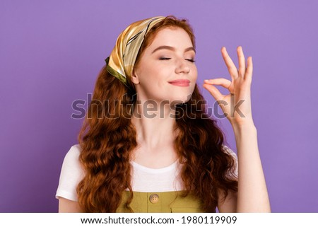 Photo of joyful happy young attractive woman hold hand fingers chef kiss tasty isolated on purple color background Royalty-Free Stock Photo #1980119909