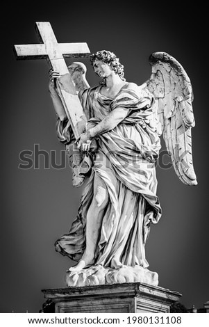 Rome, Lazio, Italy: Statue of an Angel with the Cross on Sant'Angelo Bridge in black and white with vignetting effect