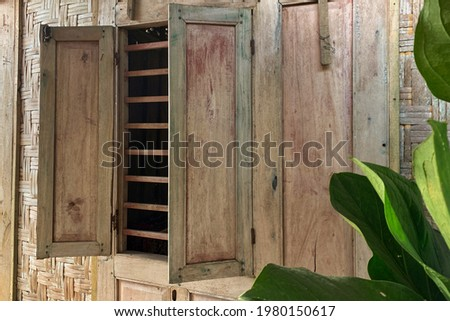 faded paint on the window of traditional Javanese houses Royalty-Free Stock Photo #1980150617