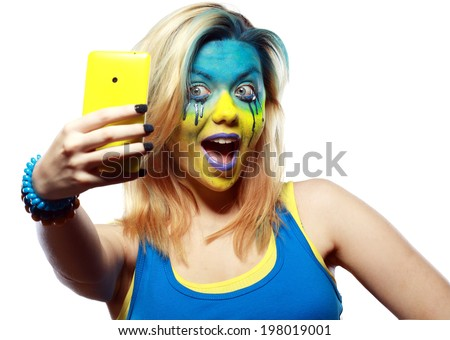 crazy color face art women portrait with yellow and blue as flag of Ukraine