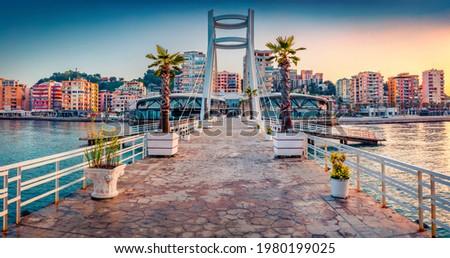 Impressive sunrise in Durres, port city on the Adriatic Sea in western Albania, Europe. Wonderful Adriatic seascape. Magnificent spring scene of Albania. Traveling concept background. Royalty-Free Stock Photo #1980199025