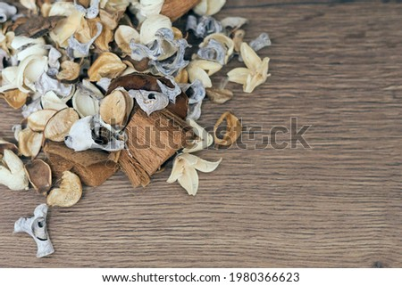 Dry white, brown and beige flowers in the wooden background, space for text  Royalty-Free Stock Photo #1980366623