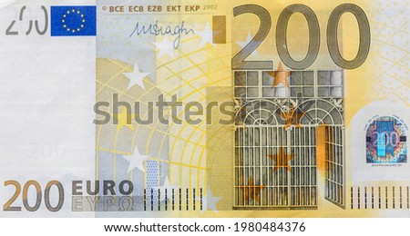 Front part of 200 euro banknote close-up with small details. European currency. Inflation, business, economics and finance theme. Royalty-Free Stock Photo #1980484376