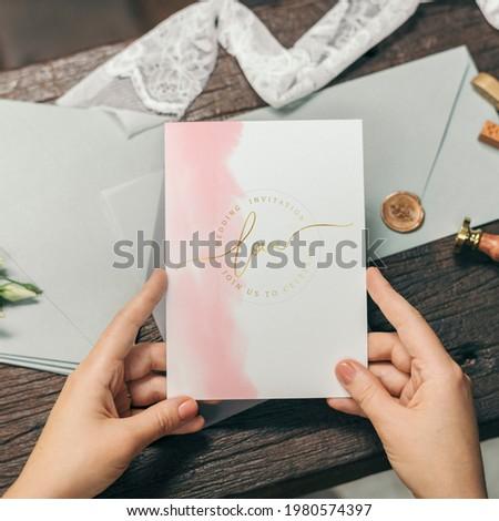 Woman with a wedding invitation card mockup Royalty-Free Stock Photo #1980574397