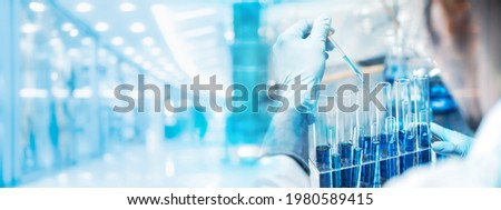 banner background, health care researchers working in life science laboratory, medical science technology research work for test a vaccine, coronavirus covid-19 vaccine protection cure treatment Royalty-Free Stock Photo #1980589415