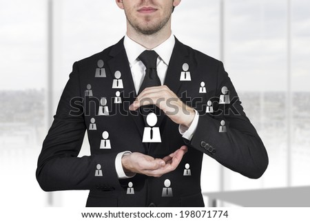 businessman in black suit protecting person chief and employees with hands #198071774