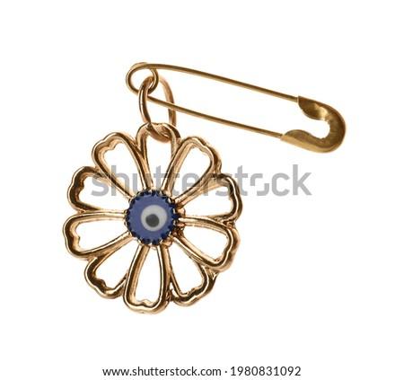 Evil eye safety pin on white background Royalty-Free Stock Photo #1980831092