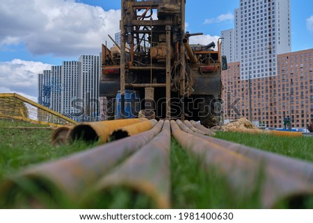 The drilling rig conducts engineering geological surveys on the city road Royalty-Free Stock Photo #1981400630