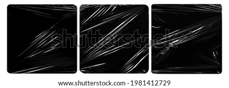 collection set of plastic wrap texture for overlay. wrinkled stretched plastic effect. transparent plastic wrap on black background. Royalty-Free Stock Photo #1981412729