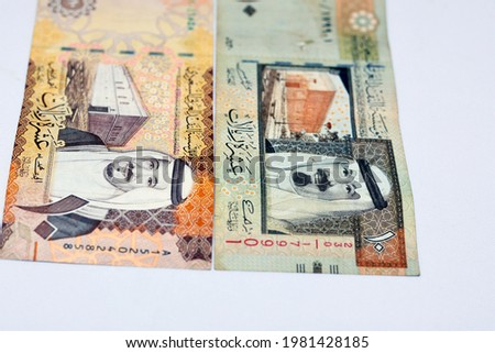 Saudi Arabia ten riyals banknotes with the photo of king Salman bin AbdulAziz and Fortress and the photo of King Abdullah and King Abdulaziz's palace in Almoraba isolated on white background