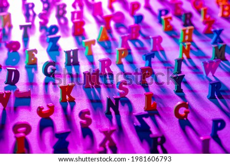 ABC letters. Latin symbols of the alphabet nearby. Some ABC characters are blurred. Multicolored ABC letters in a chaotic arrangement. Set of alphabet symbols top view. Letters as a symbol of reading