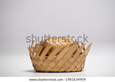 """Straw hat on a white background. Traditional object used in the June festivities in Brazil. Known as """"chapéu de palha"""" Royalty-Free Stock Photo #1981634909"""