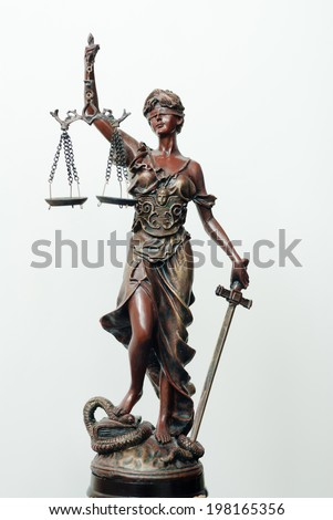 picture o themis, femida or justice goddess sculpture with right hand holding scales on white copy space background