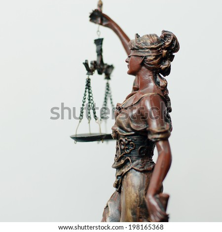 side of themis, femida or justice goddess sculpture with right hand holding scale on white copy space background picture
