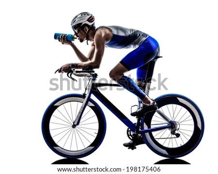 man triathlon iron man athlete biker cyclist bicycling biking drinking in silhouette on white background