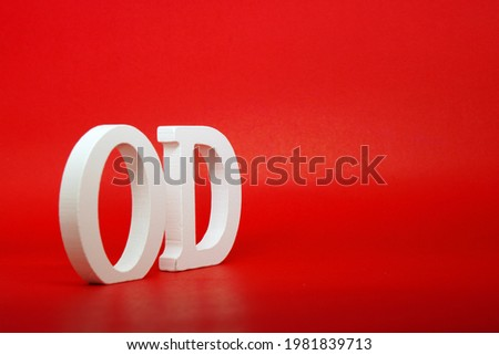 OD white letter word wooden Isolated Red Background with Copy Space - Advertise object symbol or  Education Concept