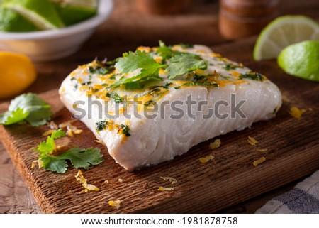 Delicious cedar planked halibut with citrus cilantro marinade.