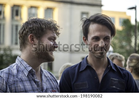 MADISON, WISCONSIN USA - JUNE 6: A gay couple getting married on the steps of the City County Building after a judge struck down Wisconsin's gay marriage ban on Friday June 6, 2014 in Madison, WI #198190082