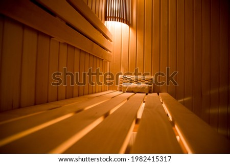 Wooden headrest made of linden on the shelf in the sauna Royalty-Free Stock Photo #1982415317