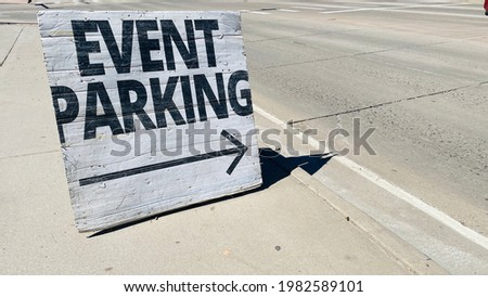 Event Parking Wooden Street Sign in City