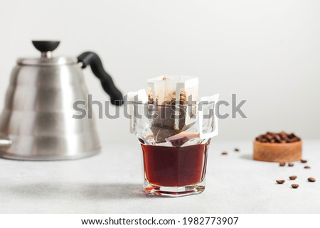 Drip coffee bag in a mug. Trends in brewing coffee at home. Royalty-Free Stock Photo #1982773907