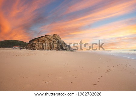 Aerial view of waves on a beautiful sandy ocean beach and cliff at the sunset. Panorama atlantic coastline. Royalty-Free Stock Photo #1982782028