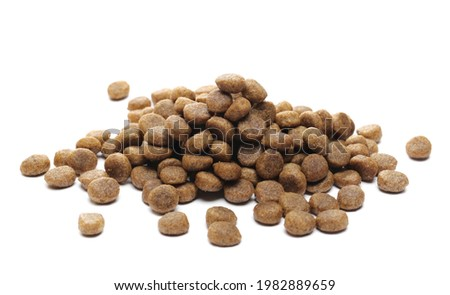 Dog food pile, dry granules for puppies and young dogs isolated on white background Royalty-Free Stock Photo #1982889659