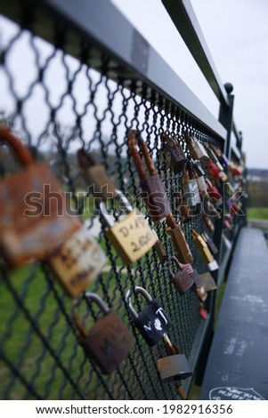 Lots of padlocks on the railing of the footbridge. Padlocks symbolizing love relationships.