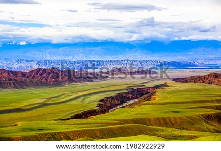 A cleft in a mountain valley. Mountain valley cleft landscape. Cleft in mountain valley