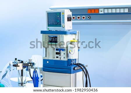Anesthesia and respiratory apparatus in intensive care. Anesthesia and respiratory apparatus on. Indicators of patient condition on monitor. Equipment for the administration of anesthetized patient Royalty-Free Stock Photo #1982950436