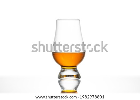 GLASS of WHISKY in GLENCAIRN GLASS. Glasses. Scotch Whisky in Glass. Alcohol Whiskey Brandy Cognac Bourbon Scotch Dram Scotland Scottish Culture Tot Against White Background. Clipping Path in JPEG