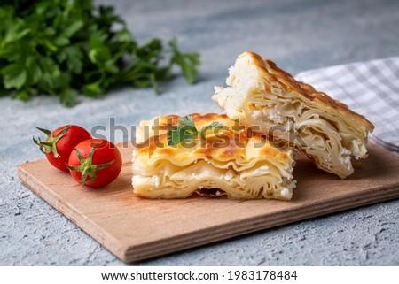 Delicious Turkish food; Tray pastry; (Turkish name; Su boregi) Royalty-Free Stock Photo #1983178484