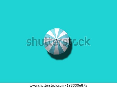 Top view, Single white and cyan umbrella isolated on cyan background, stock photo, invesment, business, summer concept