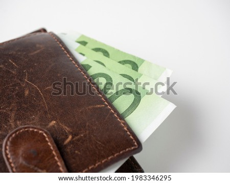 Close-up of a brown leather wallet full of one hundred euro bills. The concept of wealth, success, and finance Royalty-Free Stock Photo #1983346295