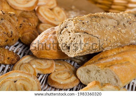 Picture of different assortment of bread and bakery products on table