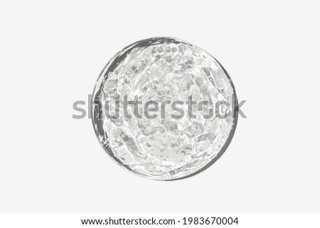 Close-up transparent cosmetic gel in glass isolated on white background. Make-up and cosmetics texture background, skincare product.  Royalty-Free Stock Photo #1983670004