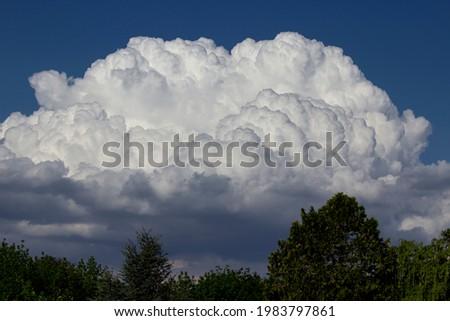 Cumulus clouds nimbus on blue sky Royalty-Free Stock Photo #1983797861