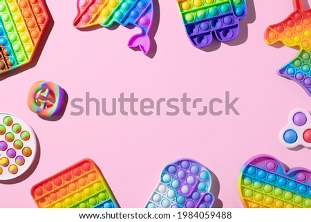 Silicone toys antistress pop it, simple dimple. New trend fidget for kids Royalty-Free Stock Photo #1984059488